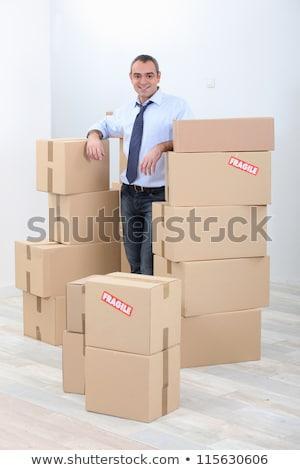 Adam karton kutuları kırılgan ev arka plan Stok fotoğraf © photography33