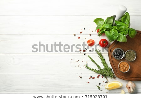 Mortar with garlic on white background Stock photo © Bunwit