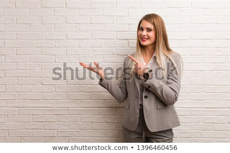 Business woman presenting something imaginary Stock photo © evgenyatamanenko