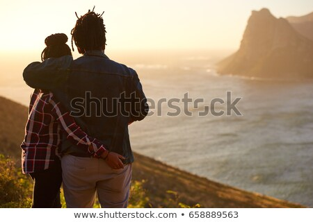 casual man with hand in pocket at sunset looks away stock photo © feedough