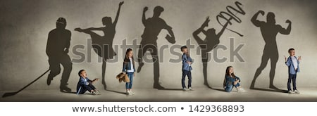 kid play bat man stock photo © araga