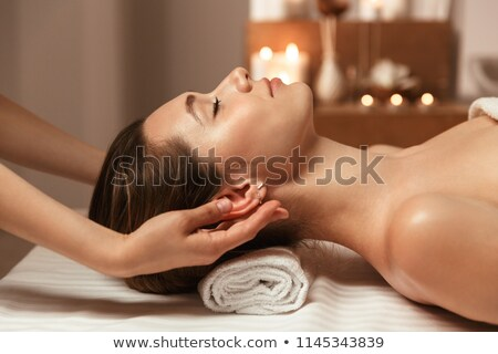 beautiful young woman getting head massage stock photo © stockyimages