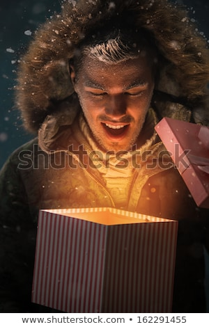 Suprised Young Boy Opens Christmas Gift Outside Stock photo © feverpitch