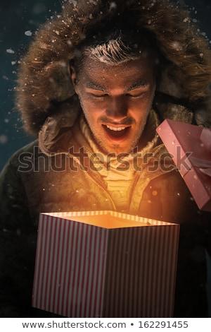 christmas · geschenk · buiten · gelukkig · gezicht - stockfoto © feverpitch