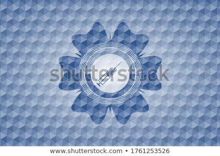 Syringe Icon on Triangle Background. Stock photo © tashatuvango