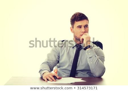 Endişeli işadamı boş kağıt genç çekici bakıyor Stok fotoğraf © jeliva