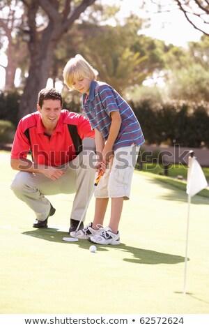 Père enseignement fils jouer golf vert Photo stock © monkey_business