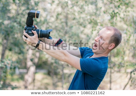 Beginner photographer with digital camera and funny guy with umb Stock photo © Nejron