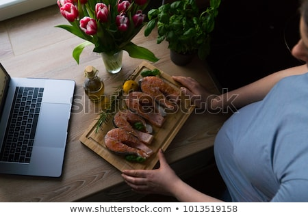 Woman eating raw red pepper, top view Stock photo © stevanovicigor