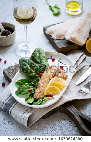 Baked fish served on Plate ready to eat  Stock photo © tab62