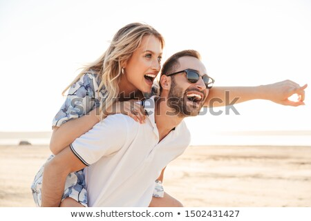Two girlfriends, seduction two men on the beach  Stock photo © Geribody