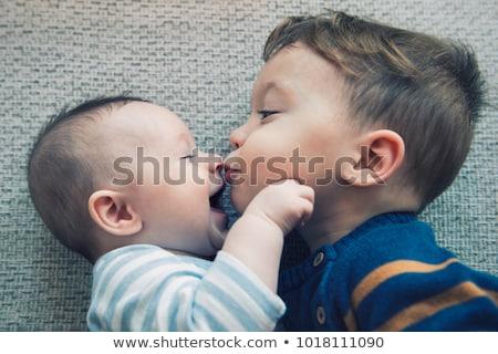 menino · mão · boca · caucasiano - foto stock © phakimata