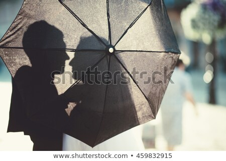 Two joyous young women with colorful umbrellas Stock photo © majdansky