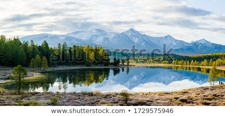 Stock photo: peaks in the haze and clouds