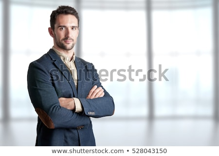Handsome smiling businessman with arms crossed Stock photo © wavebreak_media