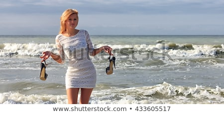 blond tourist girl with flip flop shoes white dress stock photo © lunamarina