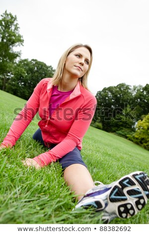 middle age woman doing split exercises Stock photo © Flareimage