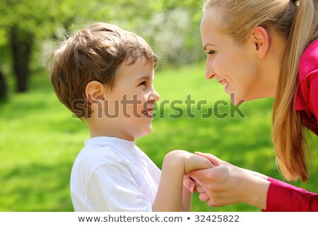 Mother and son look against each other having joined hands in pa Stock photo © Paha_L