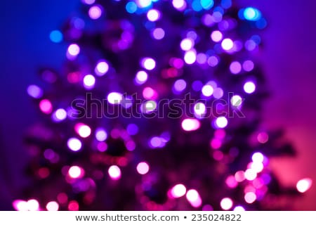 Background of defocussed color lights with sparkles Stock photo © tycoon