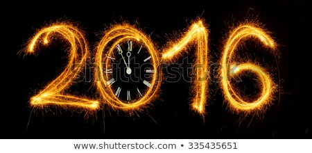 Happy New Year - 2016 with clock face made with sparklers on bla Stock photo © vlad_star