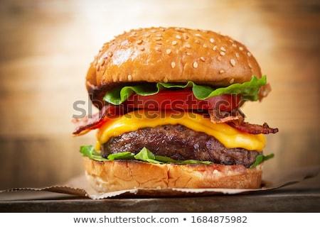 Cheeseburger hambúrguer isolado branco tomates alface Foto stock © Digifoodstock