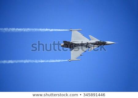 Jet flying high up in the air Stock photo © klikk