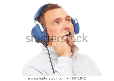 Pilot with headset looking aside  Stock photo © Amaviael