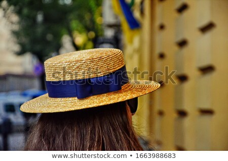 woman in swimsuit and sun hat from back over city Stock photo © dolgachov