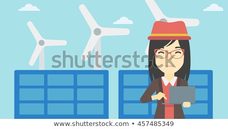 Stock photo: Female worker of solar power plant and wind farm.