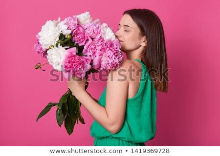 happy woman smelling big white rose at home stock photo © dolgachov