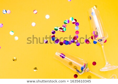 Stock photo: Glasses of yellow and pink champagne with splashes