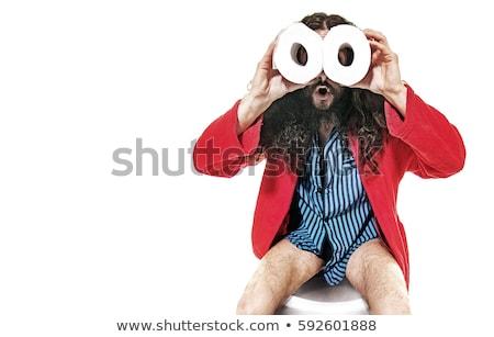 funny geek guy sitting on the lavatory stock photo © konradbak