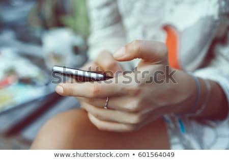 close up of woman texting on smartphone Stock photo © dolgachov