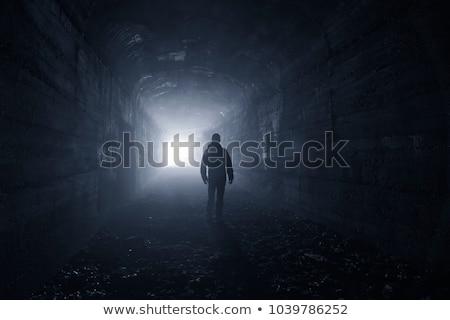Homme tunnel regarder lumière permanent centre Photo stock © adamr