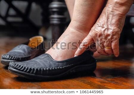 Nonna gambe pantofole piedi isolato Foto d'archivio © popaukropa