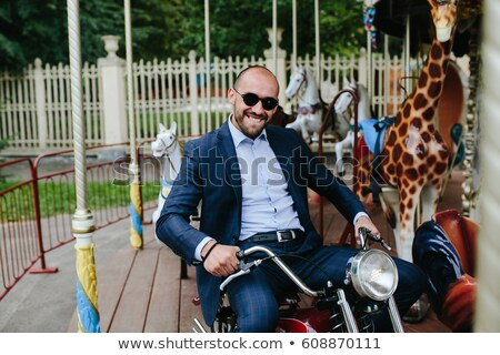Man sitting at motorcycle on the carousel Stock photo © tekso