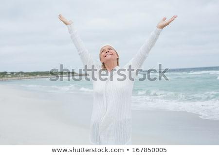 Idős nő karok a magasban áll homok tengerpart Stock fotó © wavebreak_media