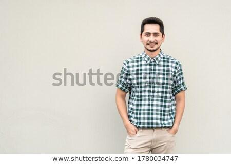 jovem · feliz · asiático · homem · falante · telefone - foto stock © deandrobot