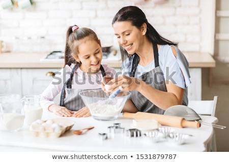 mother and daughter preparing food Stock photo © IS2