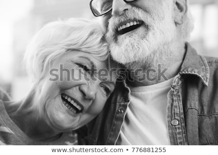 Senior couple smiling to each other Stock photo © IS2