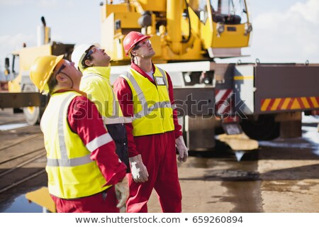workers on oil rig examining crane stock photo © is2
