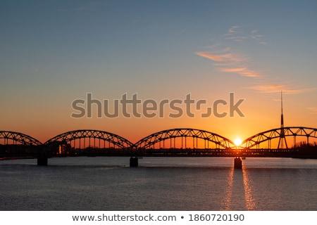 riga radio and tv tower and railway bridge stock photo © benkrut