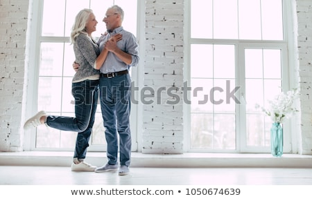Senior couple standing in living room Stock photo © IS2