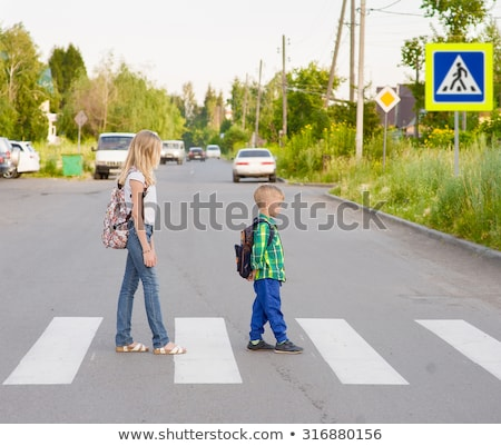 A Happy Boy Crossing the Road Stock photo © bluering