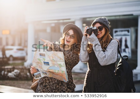 happy young woman with travel bag and map in city stock photo © dolgachov