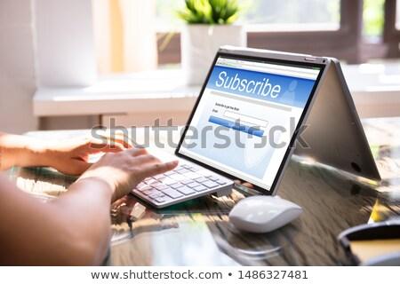 Laptop online abbonamento forma schermo Foto d'archivio © AndreyPopov