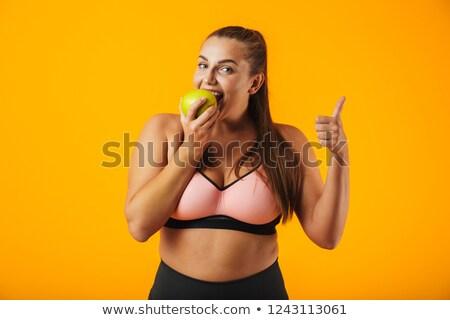 Portret dorosły pyzaty kobieta biustonosz jedzenie Zdjęcia stock © deandrobot