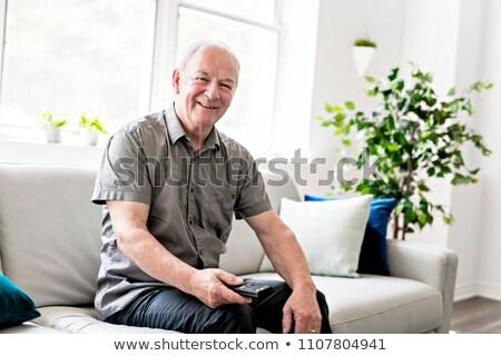starszy · człowiek · oglądania · telewizja · strony · domu - zdjęcia stock © lopolo