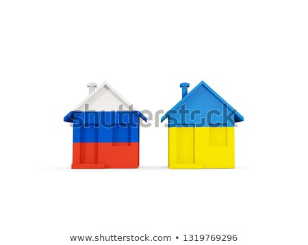 Two houses with flags of Russia and ukraine Stock photo © MikhailMishchenko
