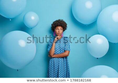 Peinzend jonge afrikaanse vrouw zomer jurk Stockfoto © deandrobot